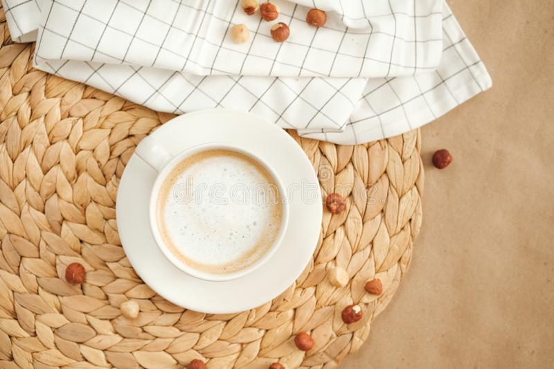 Hot morning coffee and nuts on craft paper royalty free stock photography
