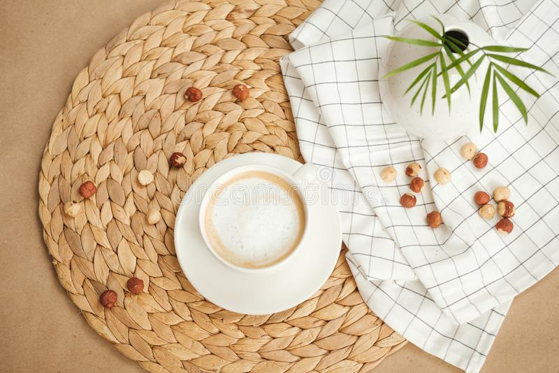 Good morning. hot morning coffee and nuts on craft paper stock photos