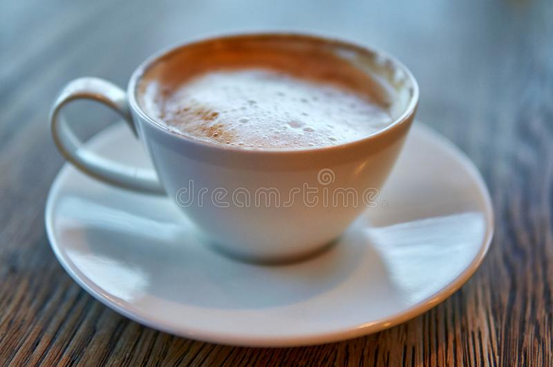 Hot Cappuccino In White Cup On Wooden Table stock photos