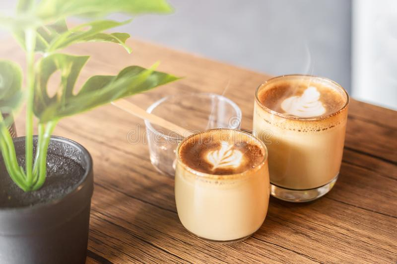 Hot cappucino in coffee shop. Hot cappucino with smoke in coffee shop stock image