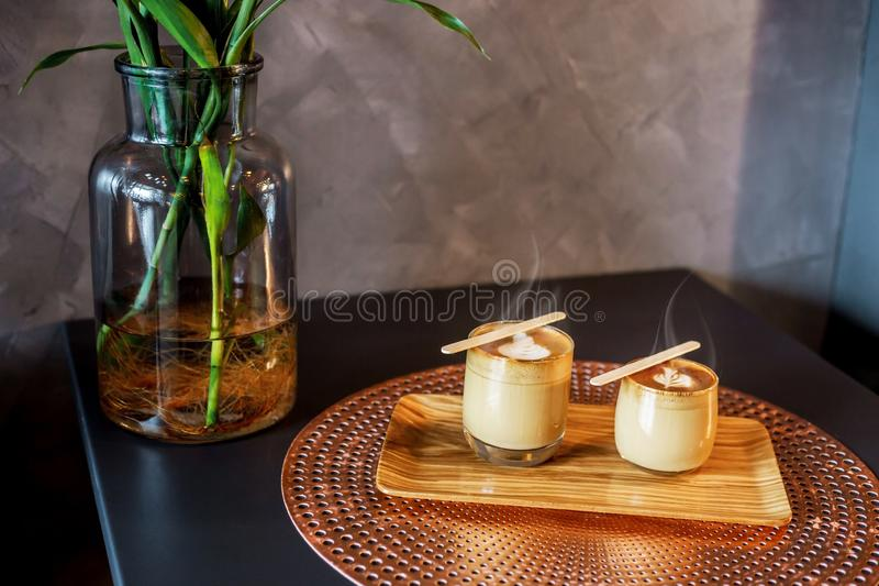 Hot cappucino in coffee shop. Hot cappucino with smoke in coffee shop royalty free stock photo