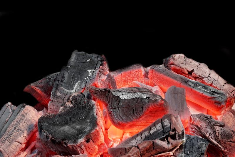 Hot Charcoal in the BBQ Grill Pit. Isolated on Black Background royalty free stock image