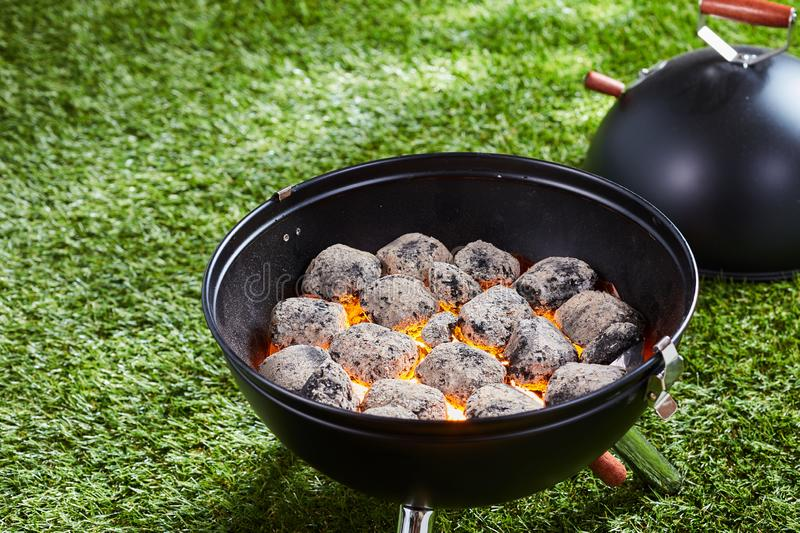 Hot charcoal or briquettes in a barbecue stock image