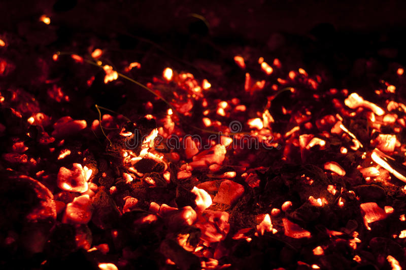 Hot charcoal fire. Bright red hot charcoal fire screensaver close up royalty free stock photography