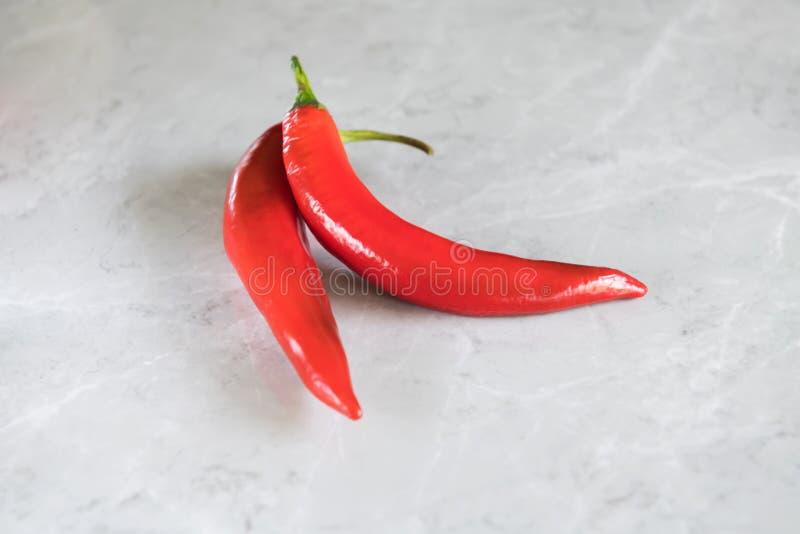 Hot chili peppers on grey marble background, crescent shaped. use for arabic sauce harissa, georgian sause adjika. Italian bio stock photography