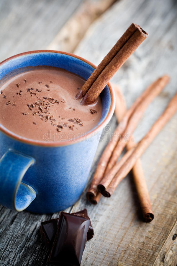 Hot chocolate. With cinnamon stick in blue cup stock image