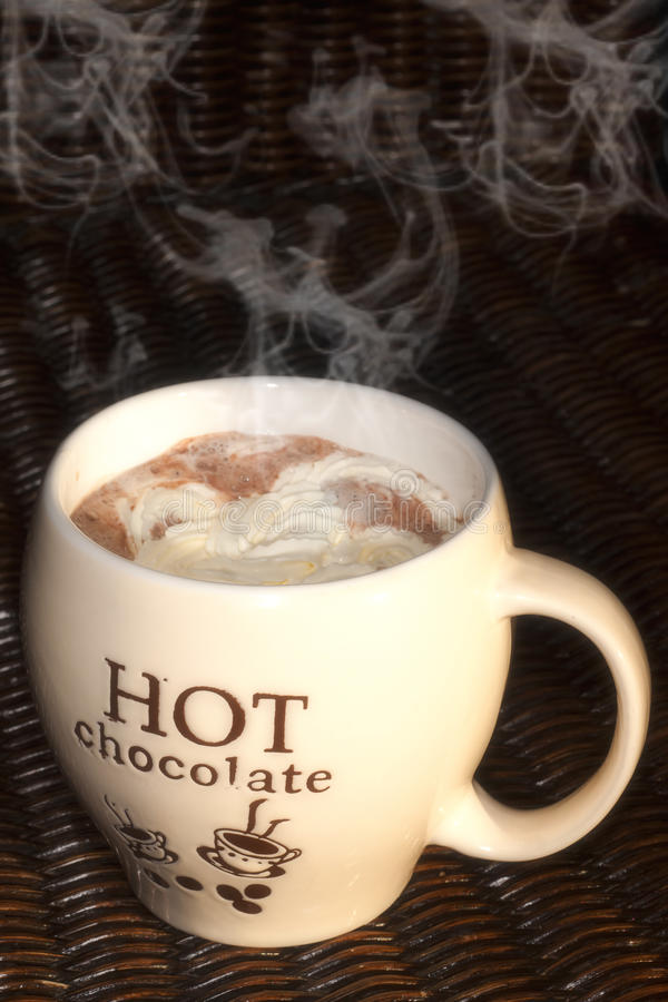 Hot chocolate. Cup of smoking hot chocolate milk with cream stock photography