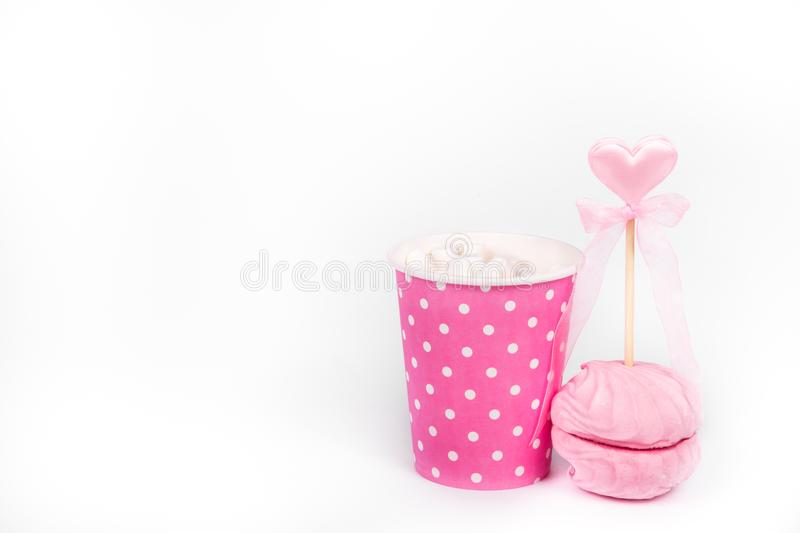Hot chocolate and airy pink marshmallow. Romantic concept. St. Valentine`s Day. Copy space royalty free stock image