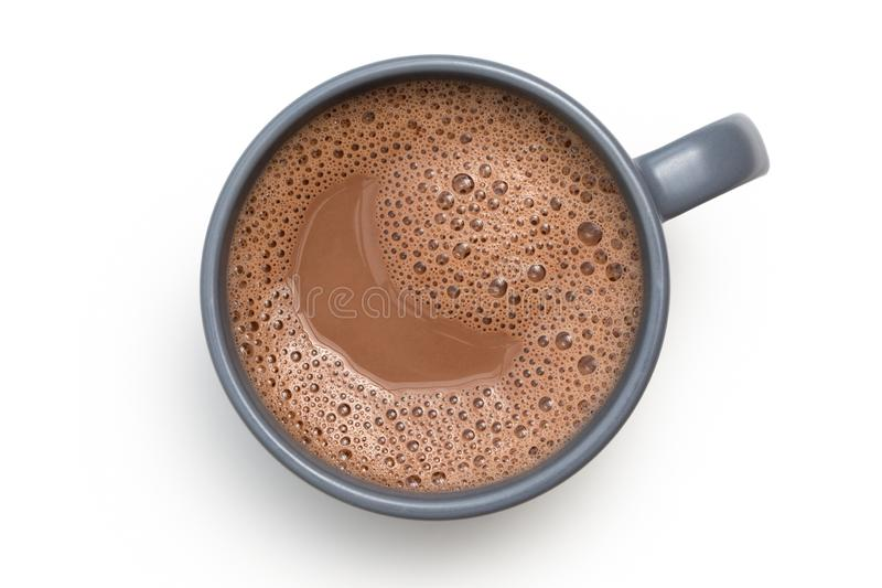 Hot chocolate in a blue-grey ceramic mug isolated on white from above.  stock image