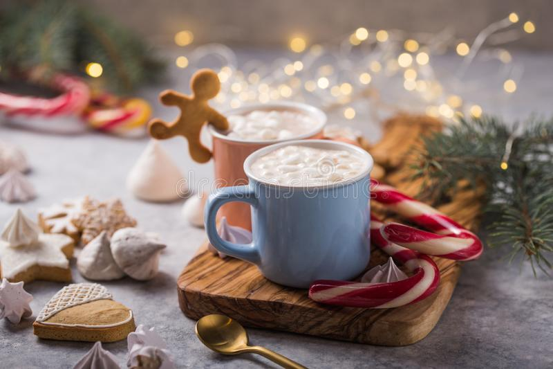 Hot chocolate cacao drinks with marshmallows in Christmas mugs on grey background. Traditional hot beverage, festive cocktail at X. Mas or New Year stock image