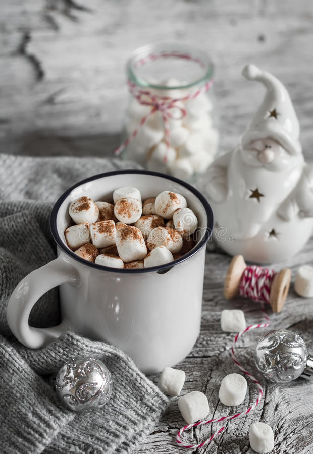 Hot chocolate and a ceramic Santa Claus. On a light wooden surface stock photo