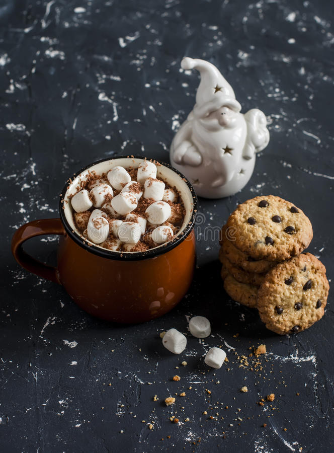Hot chocolate, chocolate chip cookies and christmas ornament Santa Claus royalty free stock photography