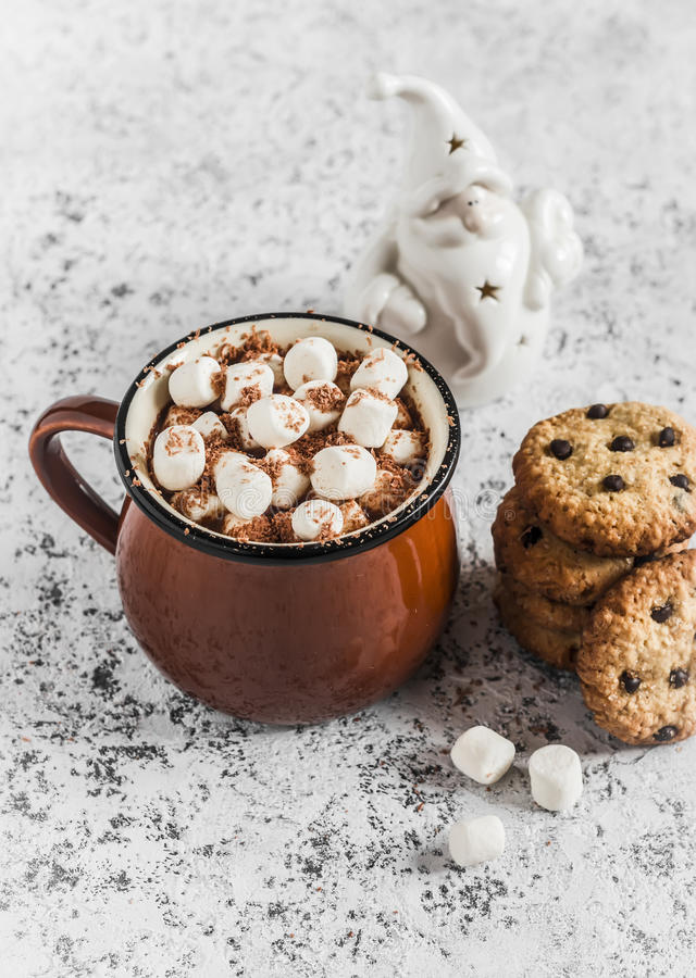 Hot chocolate, chocolate chip cookies and christmas ornament Santa Claus stock image