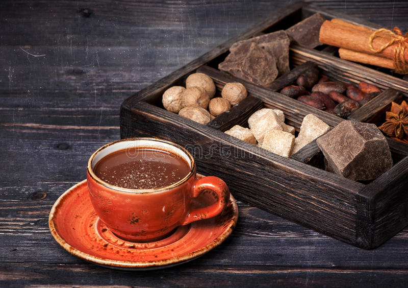 Hot chocolate, chocolate, cocoa beans and spices royalty free stock photography