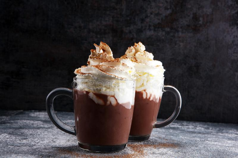 Hot chocolate cocoa with whipped cream for xmas on table.  stock photos