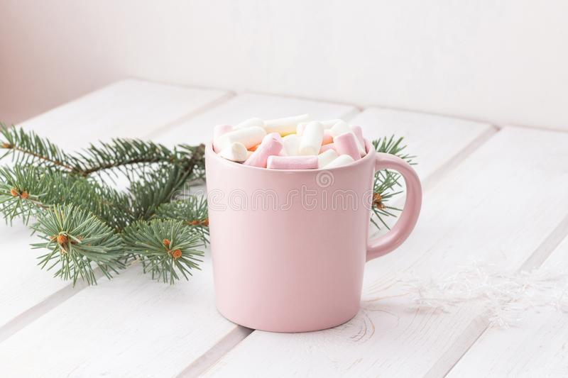 Hot chocolate coffee, cocoa with marshmallows in a pink mug royalty free stock images