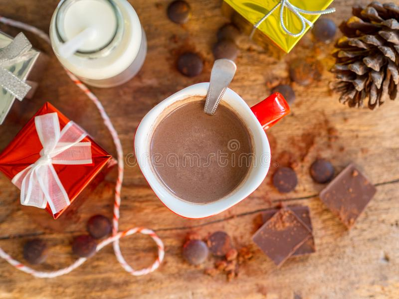 Hot chocolate cup with gift boxes and bottle of milk. stock photos