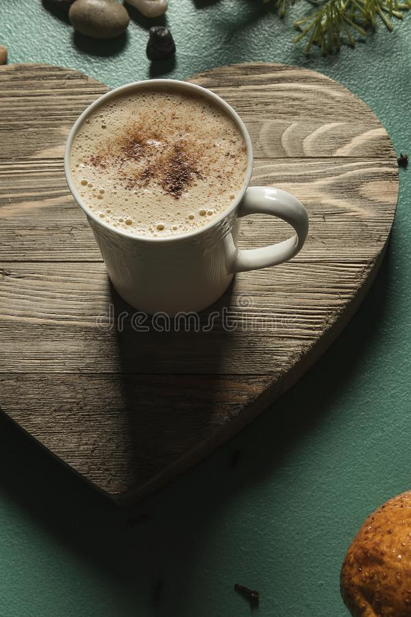 Hot Chocolate Drink on heart shaped wood green background word love. Hot Chocolate Drink on heart shaped wood green background  with foam and green background royalty free stock photos