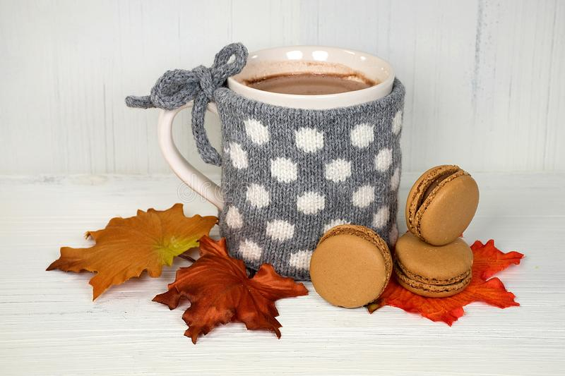 Hot chocolate drink with macaroons stock images