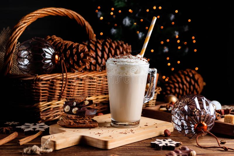 Hot chocolate drink with whipped cream. Cozy Christmas composition on a dark wooden background. Sweet treats for cold royalty free stock photos