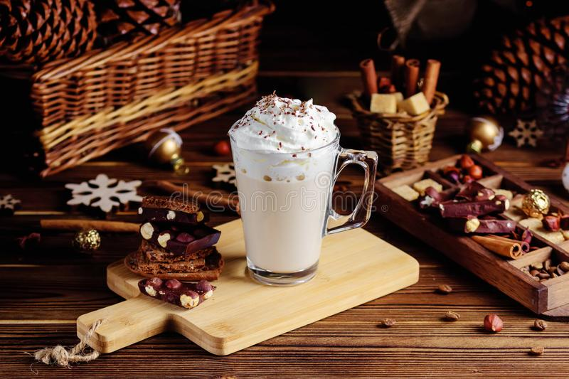Hot chocolate drink with whipped cream. Cozy Christmas composition on a dark wooden background. Sweet treats for cold royalty free stock images