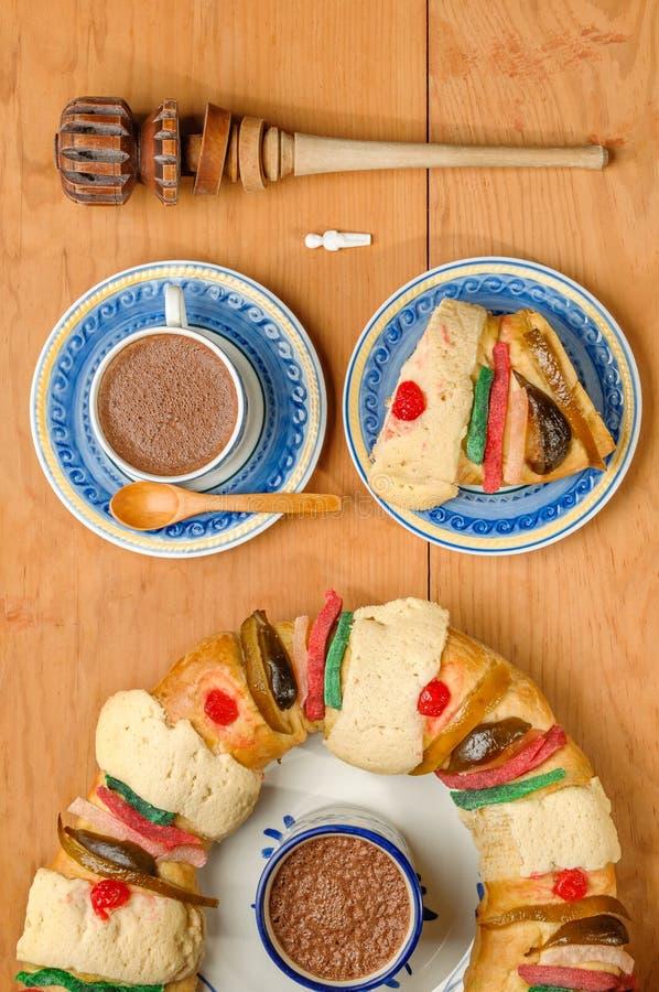 Hot Chocolate with Epiphany cake, Kings cake, Rosca de reyes or Roscon de reyes royalty free stock photos