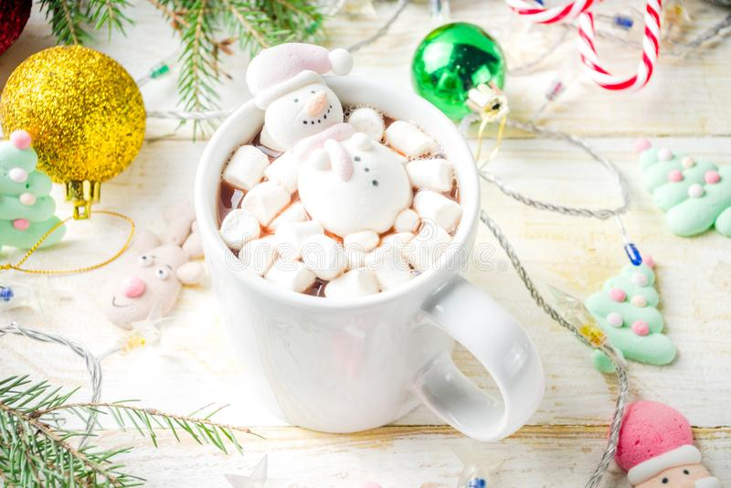Hot chocolate with funny marshmallow royalty free stock photos