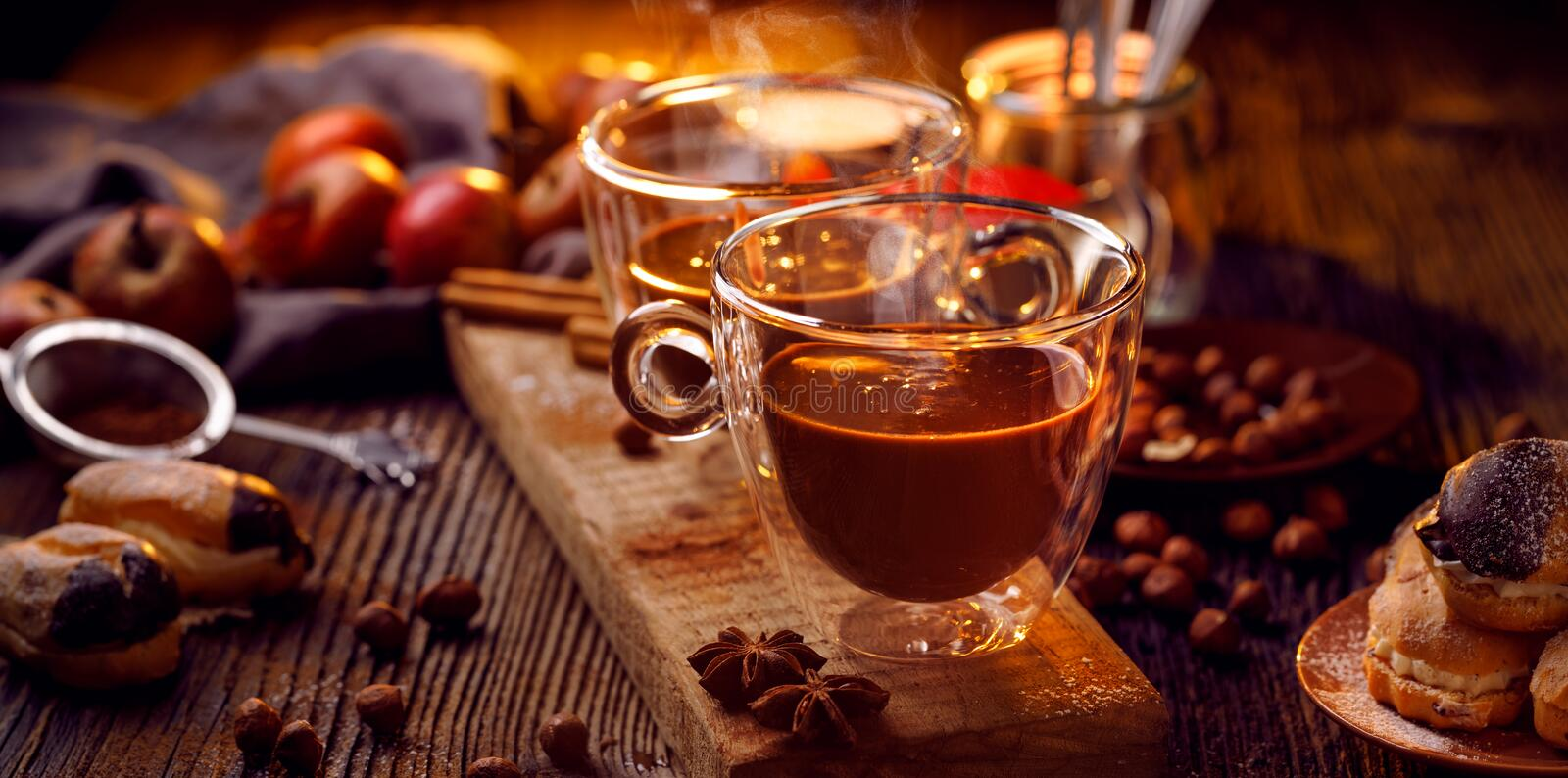Hot chocolate in glass cups on wooden table, delicious and warming drink, perfect for cold days stock photos