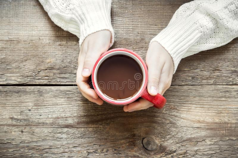 Hot chocolate in hands stock photography