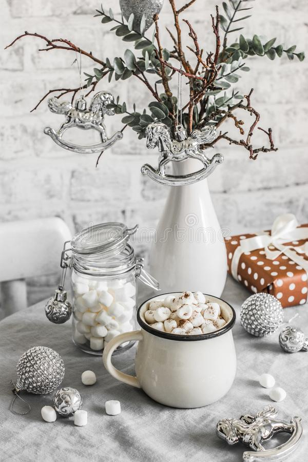 Hot chocolate with marshmallow - traditional Christmas winter warming drink on the bright kitchen table surrounded by Christmas stock photos