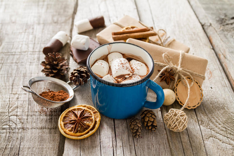 Hot chocolate with marshmallows. In blue cup, presents royalty free stock images