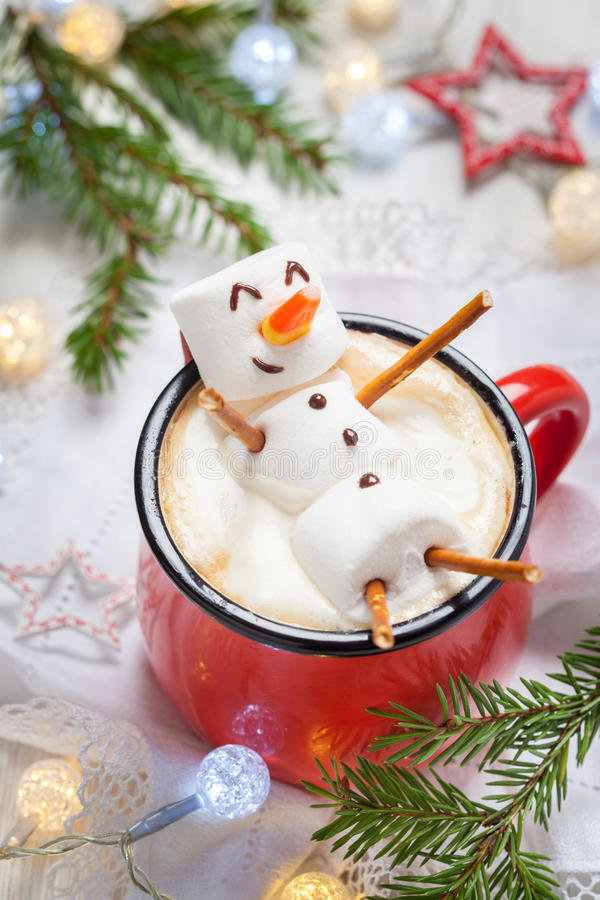 Hot chocolate with melted marshmallow snowman stock image