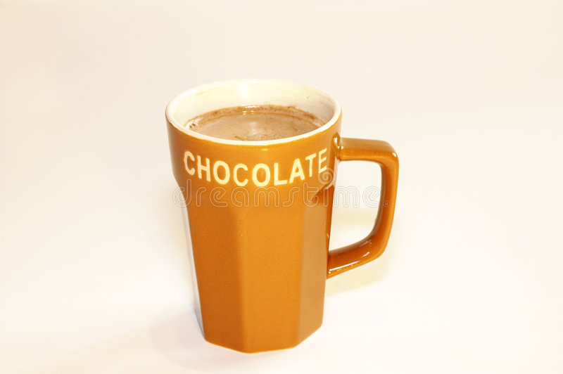 Hot chocolate milk. Cup hot chocolate milk with light background royalty free stock photos