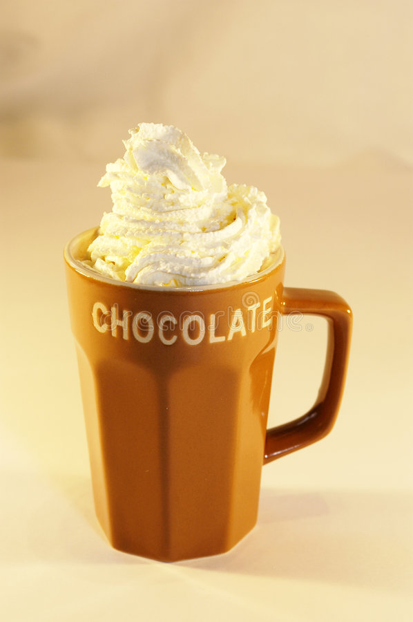 Hot chocolate milk whip cream. Cup hot chocolate milk with whip cream stock photography
