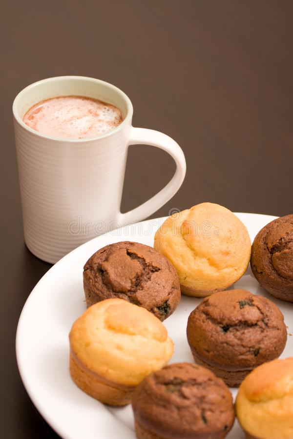 Hot chocolate and muffins royalty free stock photos