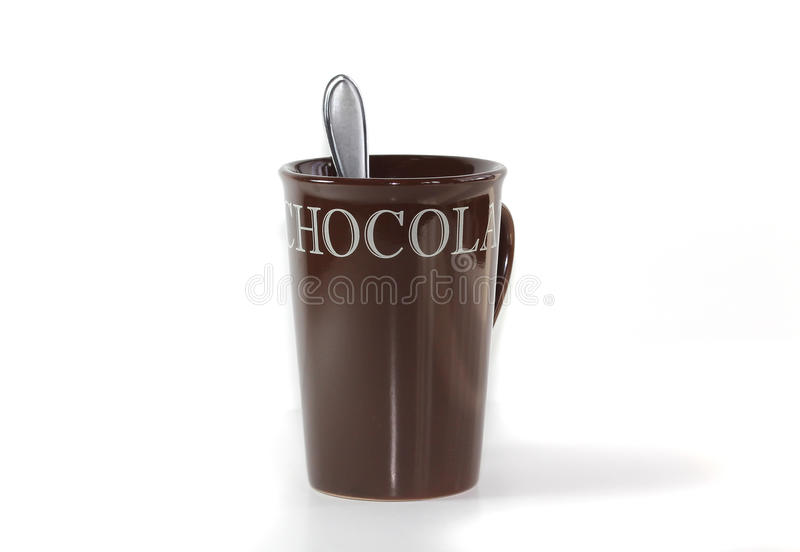 Hot Chocolate Mug. A brown hot chocolate mug with spoon is isolated on a white background. The letters on the mug spell out Hot Chocolate stock image