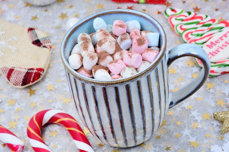 Hot chocolate in a mug and christmas ornament on table royalty free stock photo
