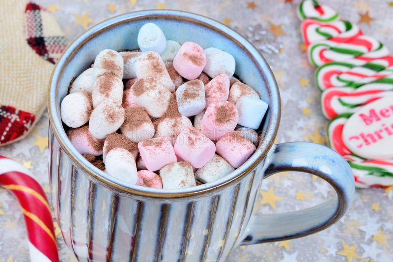 Hot chocolate in a mug with colorful marshmallow on table stock photos