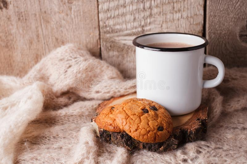 Hot chocolate warming drink wool throw cozy autumn winter cookies, christmas holiday background, copy space. stock photo