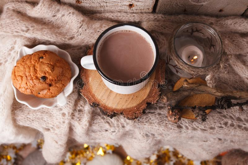 Hot chocolate warming drink wool throw cozy autumn winter cookies, christmas holiday background, copy space, top view royalty free stock photo