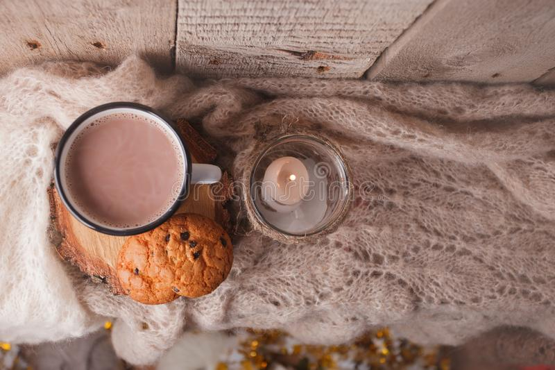 Hot chocolate warming drink wool throw cozy autumn winter cookies, christmas holiday background, copy space, top view stock image