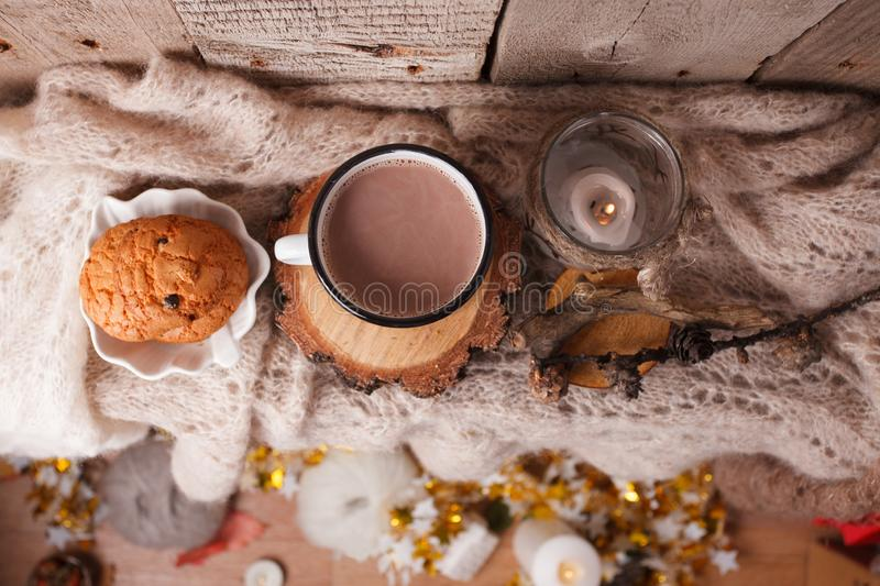 Hot chocolate warming drink wool throw cozy autumn winter cookies, christmas holiday background, copy space, top view.  stock images