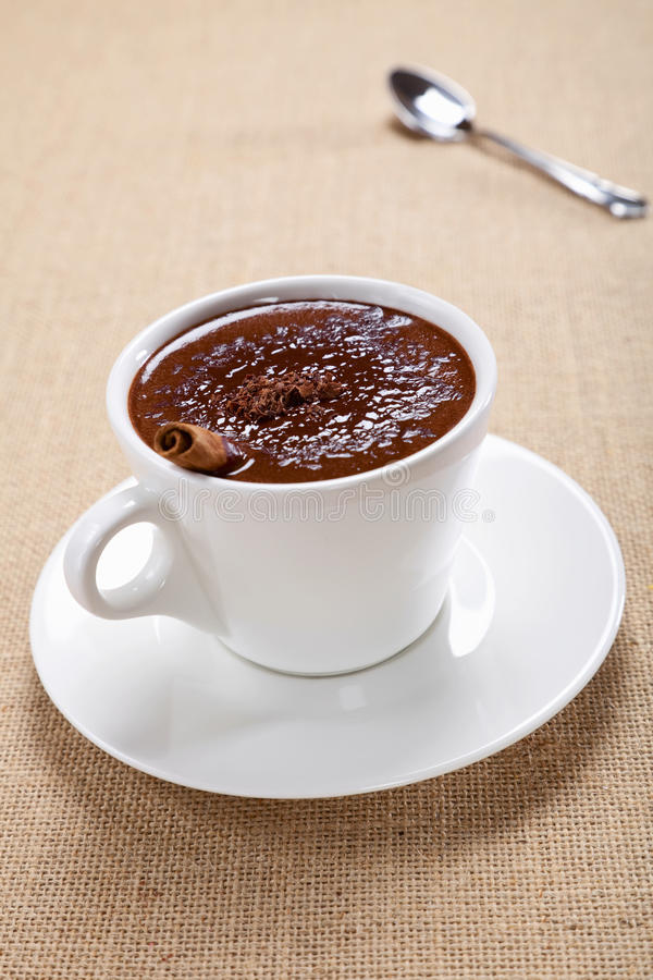 Hot chocolate in white mug, saucer and spoon royalty free stock images