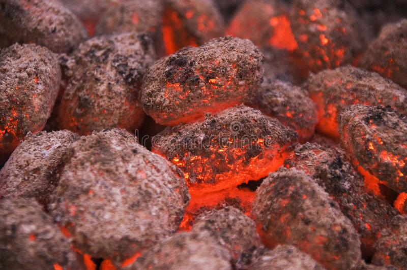 Hot coals. Or embers in a grill royalty free stock image