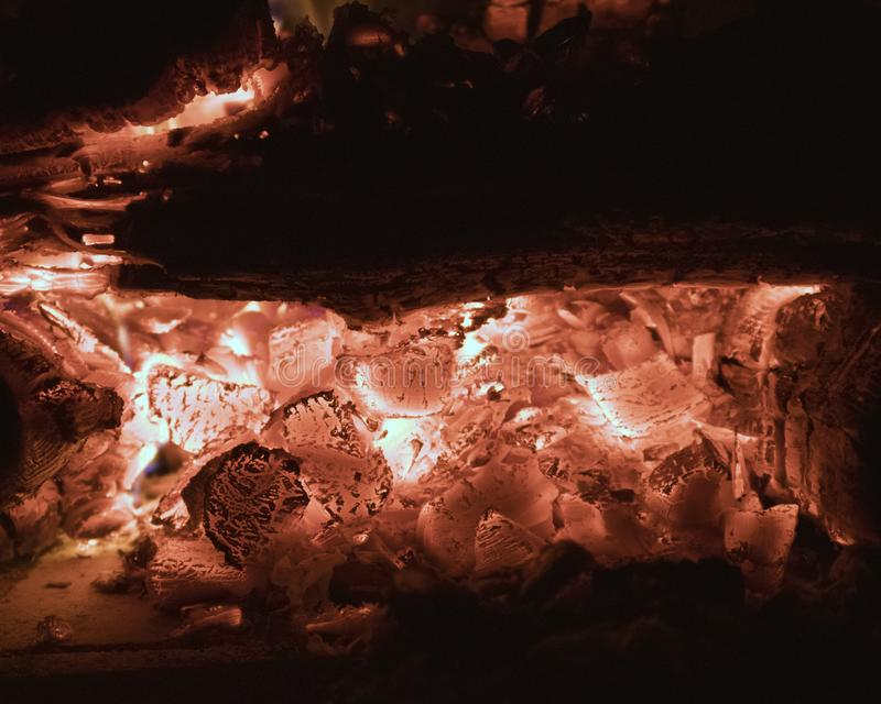 Hot coals burning out in the fireplace closeup. Glamorous natural background stock images