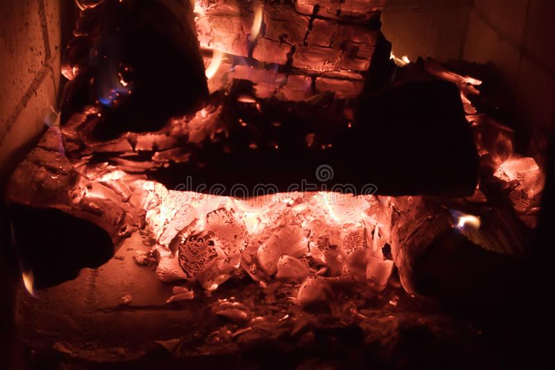 Hot coals burning out in the fireplace closeup. Glamorous natural background stock photo