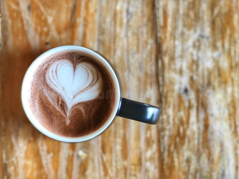 Hot cocoa cup on the wooden table, top view and copy space, royalty free stock photos