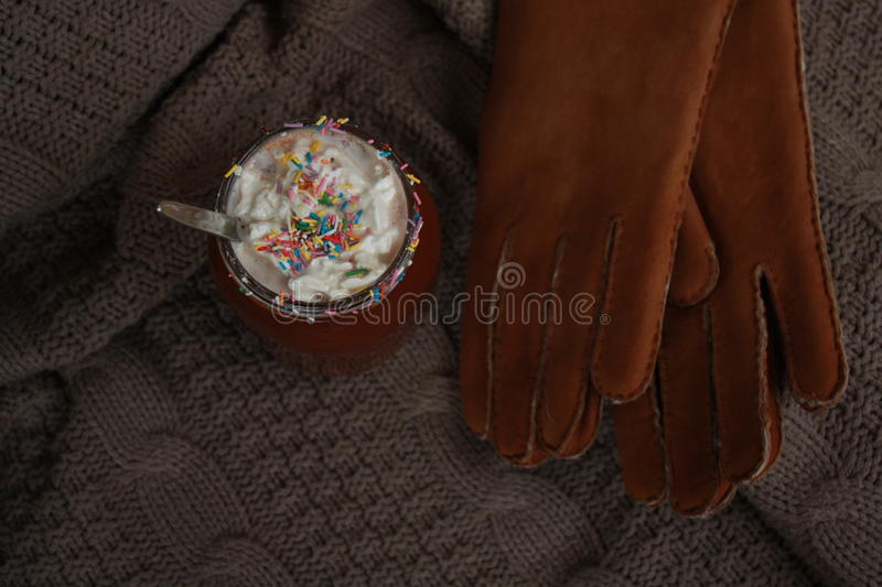 Hot cocoa with marshmallows and a number of gloves stock photos