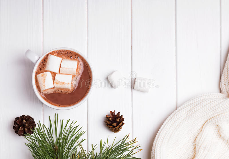Hot cocoa with marshmallows on white table stock photo