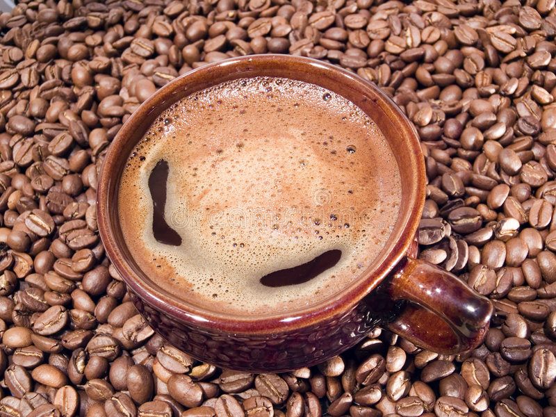 Hot coffee. Cup with hot coffee and coffee grains stock photos
